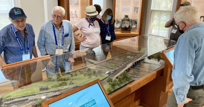 Attendees of the bi-annual New York State Canal Conference view a display at the Schoharie Crossing State Historic Site Visitor Center during a mobile workshopon Sept. 27, 2021.