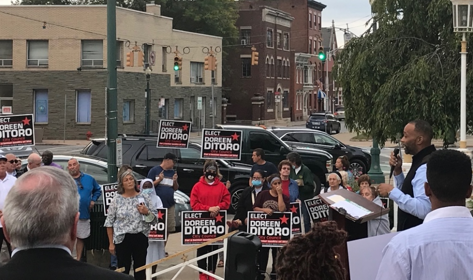 City Council candidate Damonni Farley speaks at the podium alongside supporters as fellow City Council candidate Doreen Ditoro, in front of light pole, watches on Sept. 27, 2021.