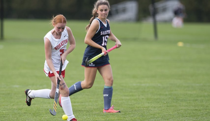 Niskayuna's Rylee Dayton, left, moves the ball upfield in front of Saratoga Springs' Adelyn Farrell on Monday during their Suburban Council field hockey game at Niskayuna High School.