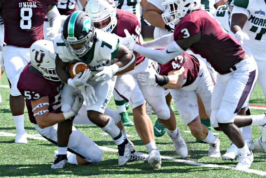 Union College linebacker Thomas Cavallo, left, makes a tackle against SUNY Morrisville at Frank Bailey Field on Set. 4.