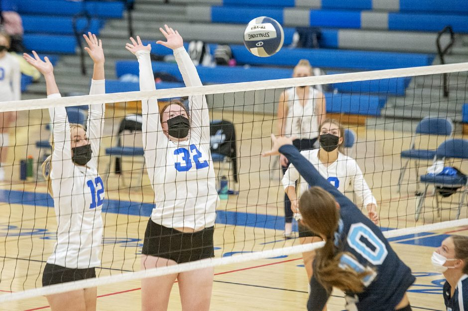 Saratoga Springs' Kaylee Stallmer and Brooke Poutre jump to block the ball against Columbia's Miranda King during Tuesday's Suburban Council girls' volleyball match.
