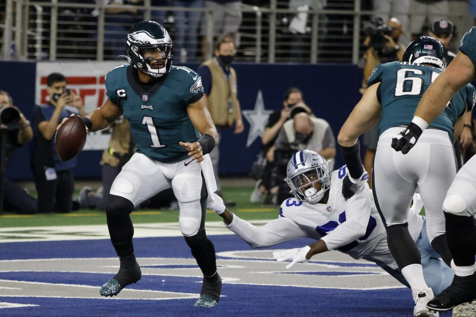 Philadelphia Eagles quarterback Jalen Hurts is pressured behind the line of scrimmage by Dallas Cowboys defensive end Tarell Basham in the first half of Monday's game in Arlington, Texas. (Michael Ainsworth/The Associated Press)