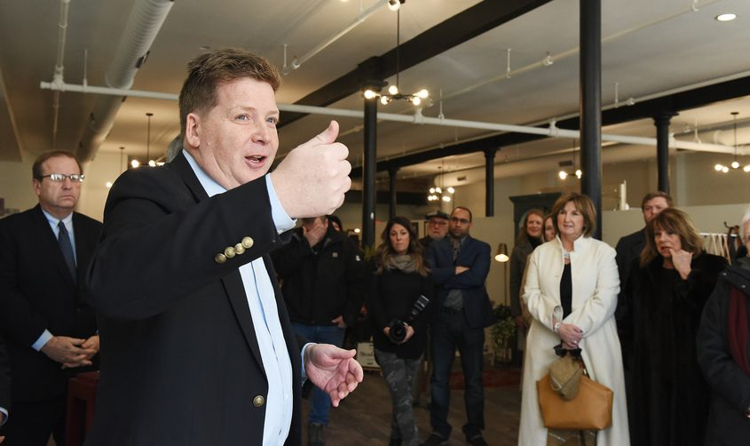 Capital Region Chamber President and CEO Mark Eagan speaks at a grand opening and ribbon cutting in Schenectadyin 2019.