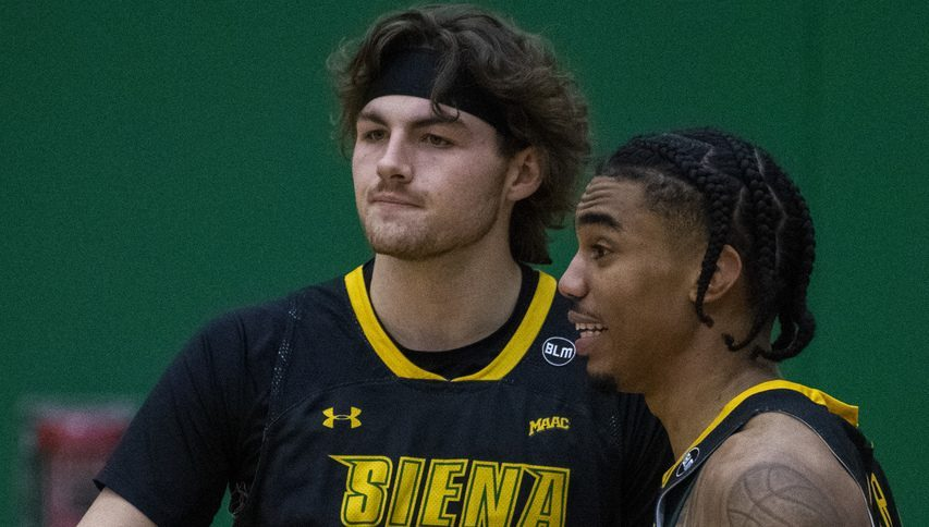 Siena's Kyle Young and Manny Camper during a game Saturday, January 23, 2021.