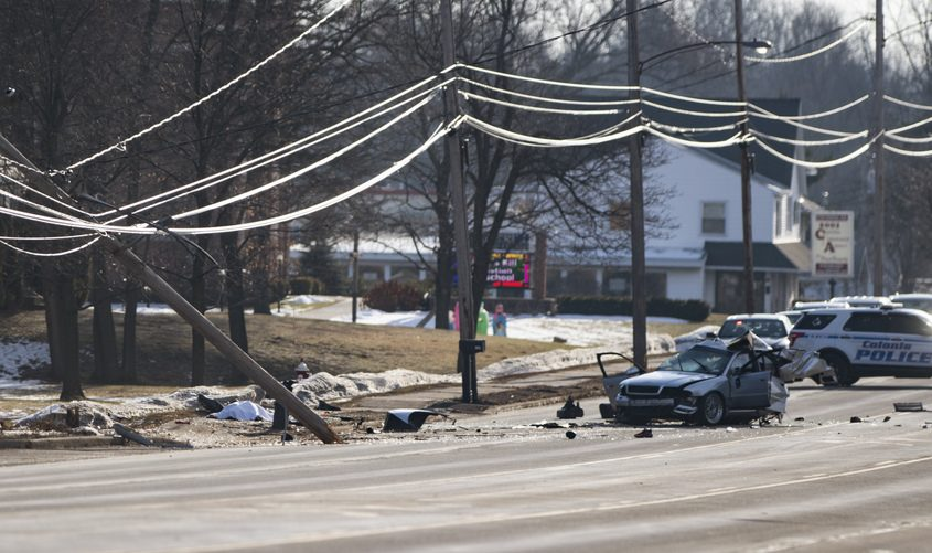 The remains of a car involved in a fatal accident lie in the westbound lane of Central Avenue in Colonie on Christmas Day in 2019.