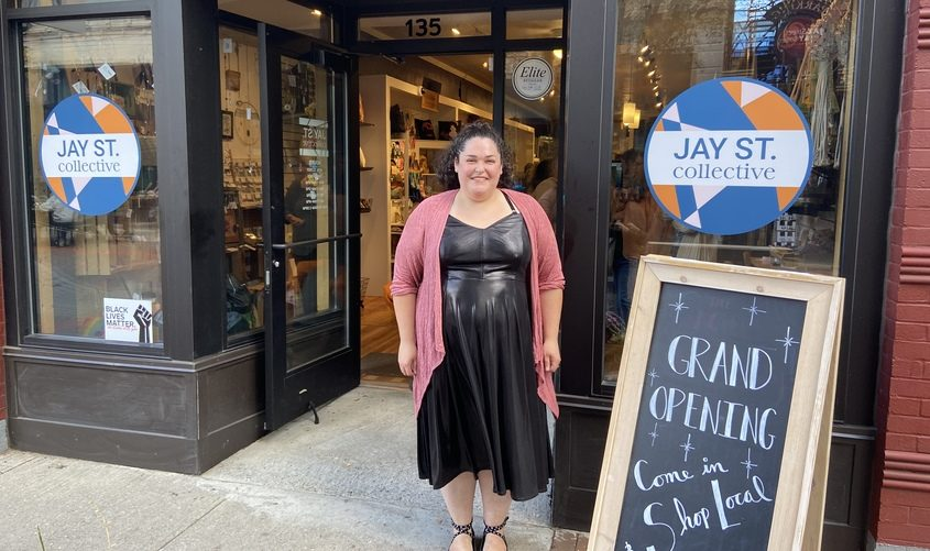 Erin Eckler poses in front of the Jay Street Collective in Schenectady Friday.
