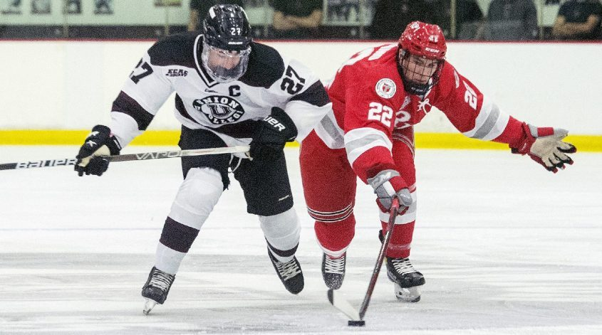 RPI's Justin Addamobattles Union's Josh Kosack during the Saturday's men's college hockey exhibition game Messa Rink.
