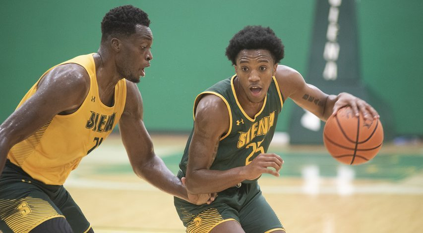 Aidan Carpenter, right, looks to get past teammate Michael Tertsea during the first day of Siena men's basketball practice Monday.