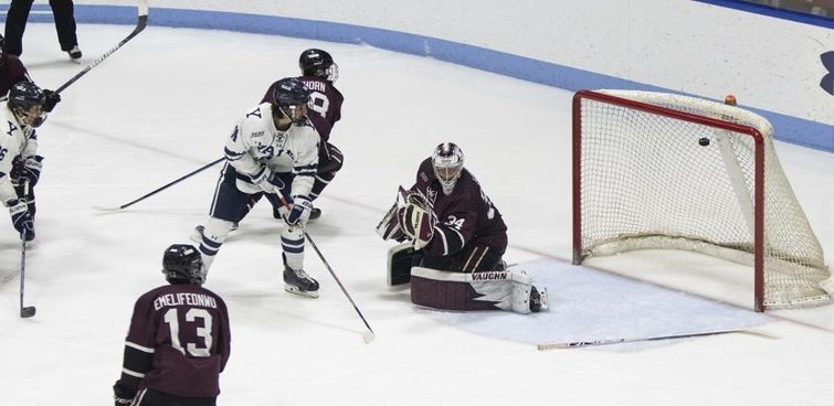 Yale gets the puck past Union goalie Darion Hanson in double overtime to win Game 3 of their ECACH quarterfinal series on March 8, 2020.
