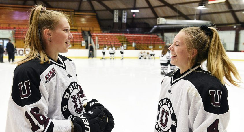 Union College women's hockey players Katie Sonntag, left, and Grace Heiting chat at media day on Sept. 29 at Messa Rink.