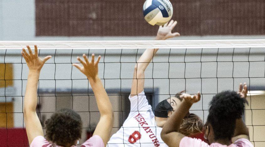 Niskayuna's Ava Schewe spikes the ball between Schenectady's Isabella Grevely and Janessa Tesheiraduring a girls' volleyball match on Thursday, Oct. 7 at Niskayuna High School.