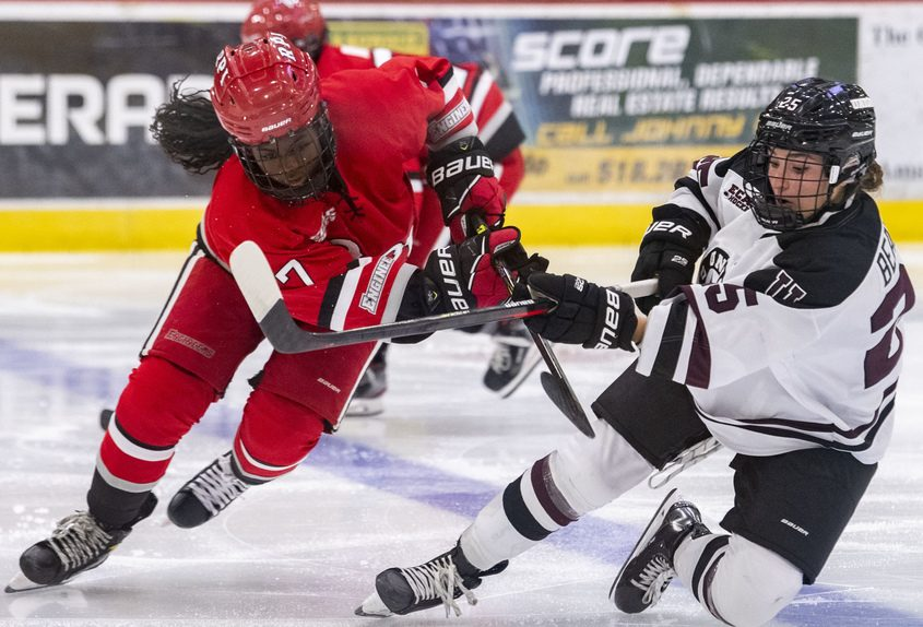 Union's Celeste Beaudoin and RPI's Nyah Philip battle for the puck during Friday's ECAC women's ice hockey game at Messa Rink.