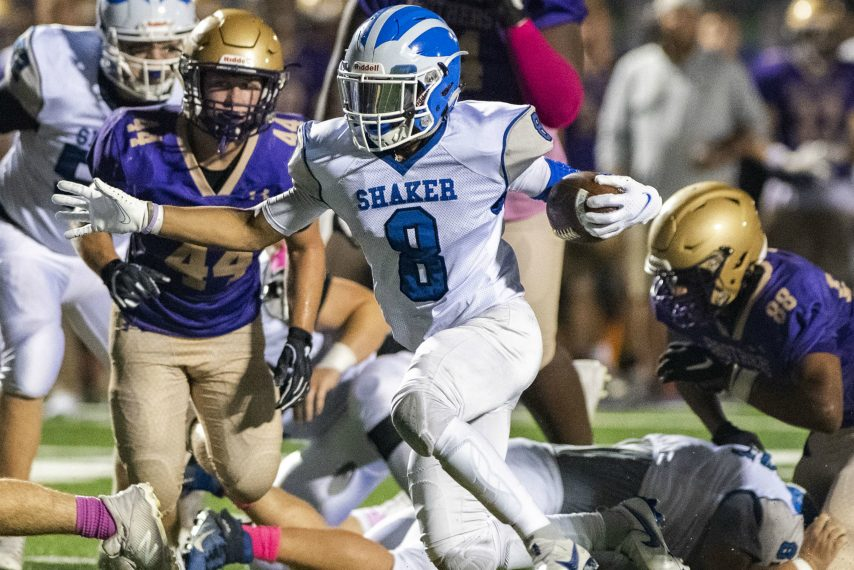 Shaker senior running back Porter Ninstant runs in for an 11-yard touchdown early in the second quarter at CBA Friday night, October 8, 2021.