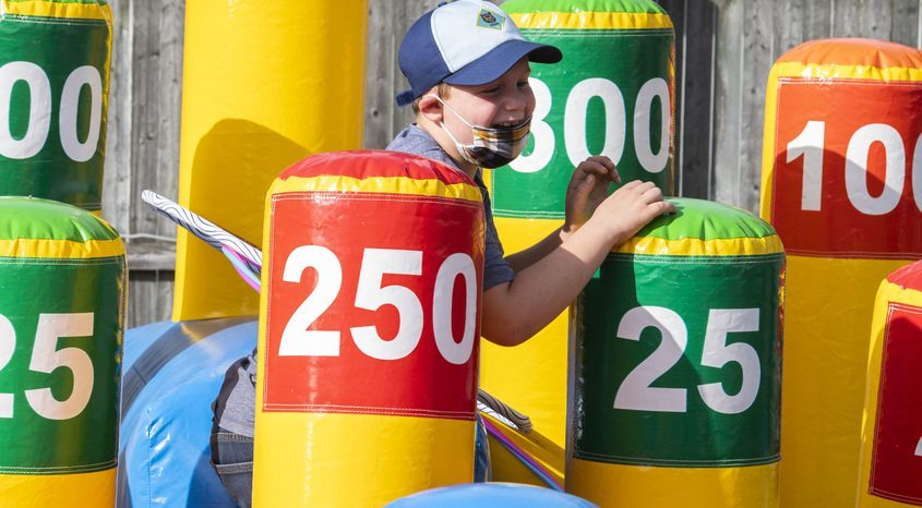 Gavin Marshall, 8, of Saratoga climbs in a ring toss game at the Twin Rivers Council Boy Scout Jamboree at the Saratoga County Fairgrounds in Ballston Spa Saturday.