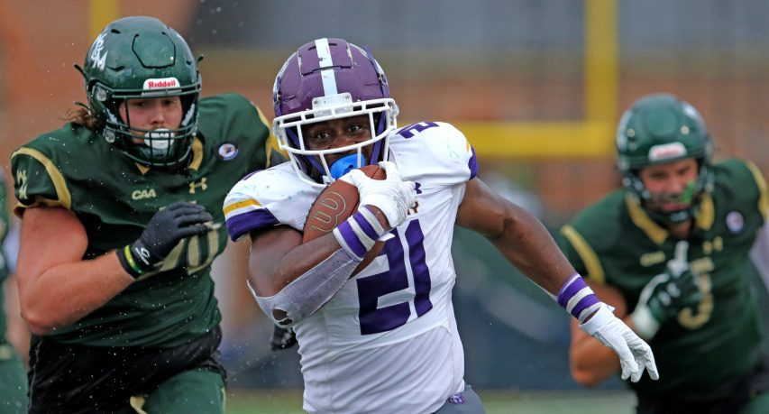 UAlbany football's Karl Mofor (21) carries the ball against William & Mary on Saturday, Oct. 9 in Williamsburg, Va. (Photo courtesy William & Mary Athletics)
