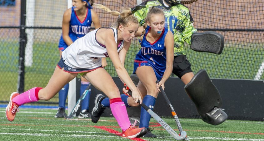 Saratoga's Aubrey Ide, left, battles South Glens Falls' Karelyn Klotz for the ball during the teams' high school field hockey game at Saratoga SpringsHigh School Monday. Ide scored the game-winner in overtime.