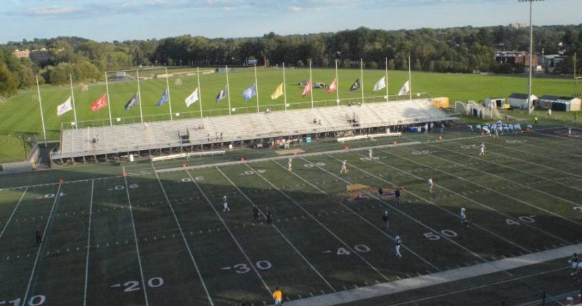 """The turf at UAlbany's Bob Ford Field at Tom & Mary Casey Stadium currently sports the university's old """"split A"""" logo."""