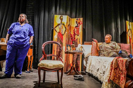 """Sade Thompson, left, plays hospice nurse Veronika and Barbara Howard plays Carolyn, a cancer patient, in """"Dead and Breathing,"""" a production of the Black Theatre Troupe of Upstate New York. (photo provided)"""
