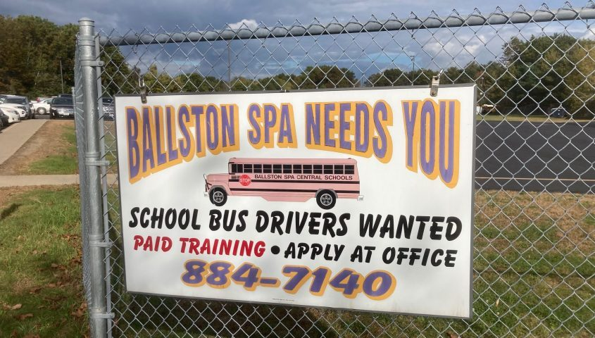Signs beckon would-be school bus drivers after shortages triggered remote learning Friday in the Ballston Spa Central School District.