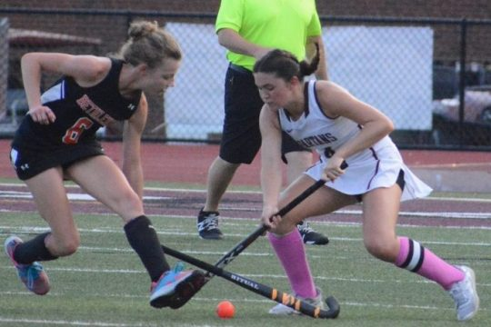 Burnt Hills-Ballston Lake's Grace Todd, right, and Bethlehem's Elizabeth Austin fight for possession during a field hockey game on Friday at Burnt Hills-Ballston Lake High School.