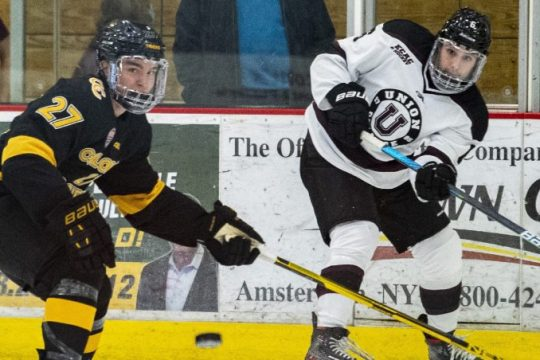 Union's Cullen Ferguson makes a rink-wide pass next to Colorado's College's Stanley Cooley on Friday at Messa Rink.