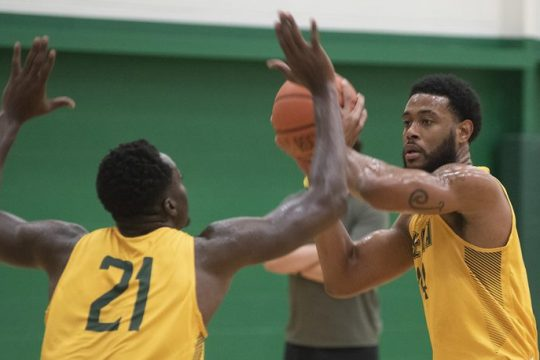 Jordan Kellier looks to pass the ball past teammate Michael Tersta (21) during the first day of Siena men's basketball practice Oct. 4, 2021.