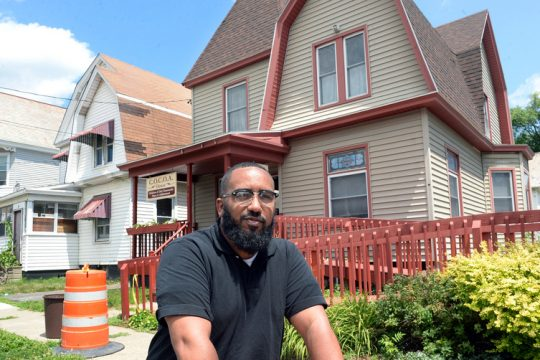 William Rivas, director of C.O.C.O.A. House, stands outside the home on Stanley St. where the afterschool program lives in Schenectady in July 2018.