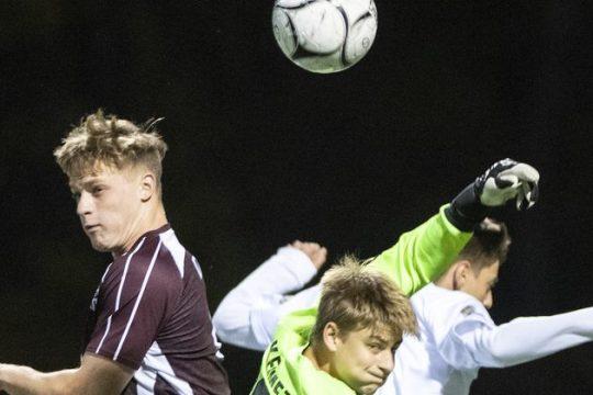 Gloversville goalkeeper Justin Kemmet and teammate Dane Dillenback go after a corner kick against Amsterdamon Wednesday.