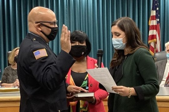 Niskayuna police officer Joseph Twitty is sworn in asthe department'snew lieutenant by town Supervisor Yasmine Syed, with help from the lieutenant's wife, Davida.
