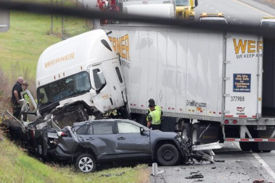 Emergency personnel work Thursday at the scene of a fatal accident on I-90 westbound between exits 24 and 25.