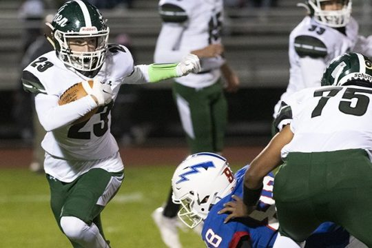 Shenendehowa running back Michael McElrath evades a Saratoga Springs defender in the first quarter during a Class AA match-up at Saratoga Springs High School Friday, October 22, 2021.