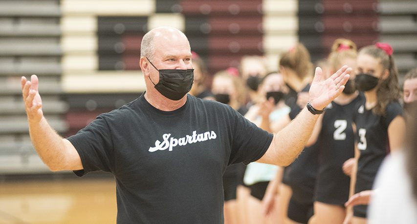 Burnt Hills-Ballston Lake girls' volleyball coach Gary Bynon celebrates the Spartans Cider Challenge Tournament win, along with his 800th career coaching win Saturday afternoon, October 23, 2021.