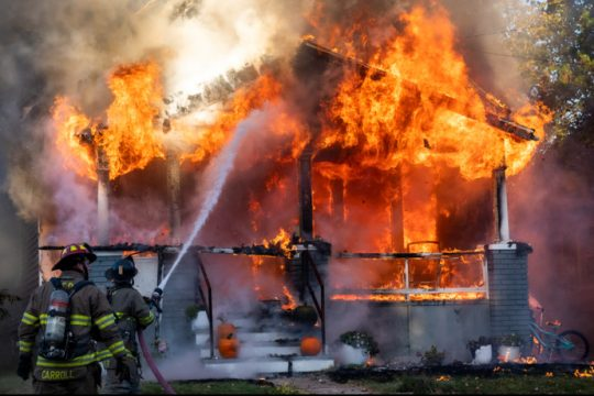 Schenectady firefighters Capt. Christopher Carroll, left, and Jared Zitwer battle the fire Sunday