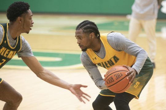 Colby Rogers, left, defends Nick Hopkins during the first day of Siena men's basketball practice on Oct. 4, 2021.