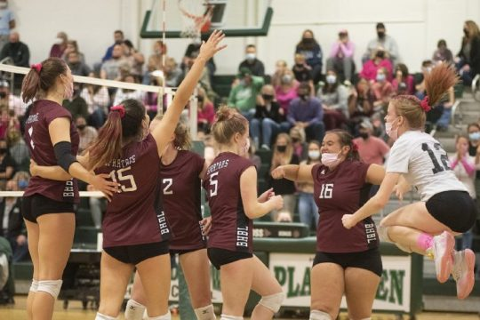 The Burnt Hills-Ballston Lake girls' volleyball team celebrates the match-winning point against Shenendehowa in a battle between two unbeaten Suburban Council teams Monday night at Shen.