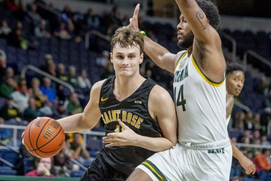 Saint Rose's Shane O'Dell, a former Schalmont High star, looks for room to dribble against Siena's Jordan Kellier during a preseason game at Times Union Center on Monday.